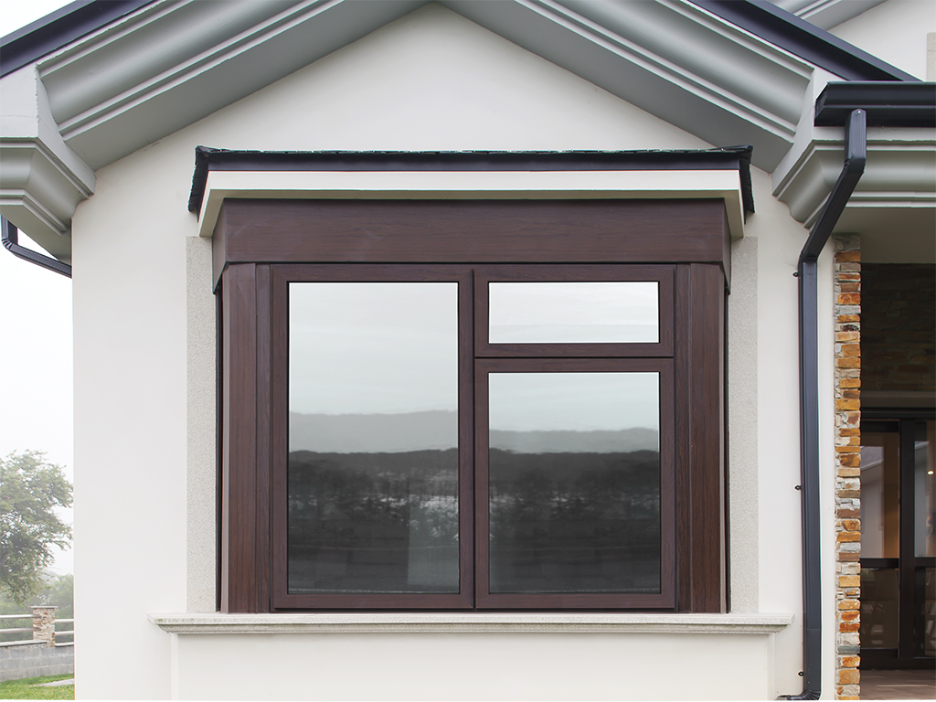 casement window in white new house with brown frame